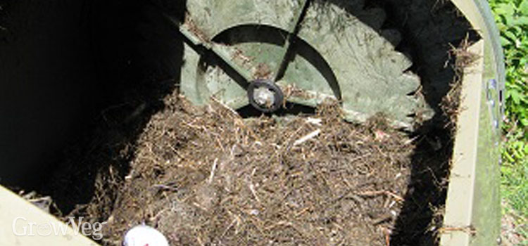 Compost tumbler contents reduced by half