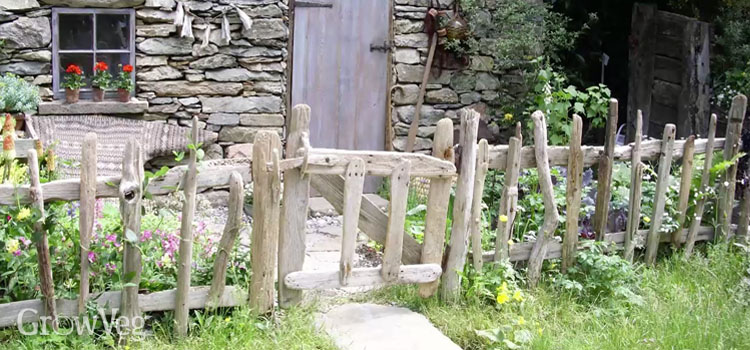 Rustic garden fence made from driftwood