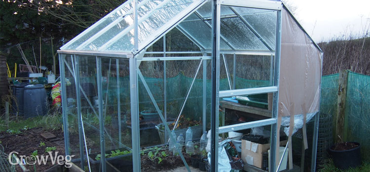 Temporary repair on a wind-damaged greenhouse