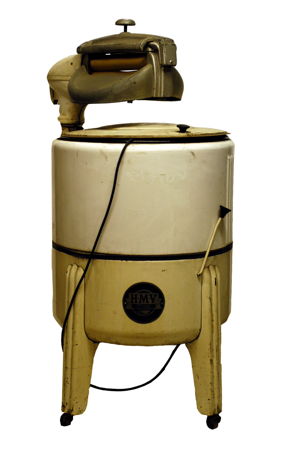 Colour photograph showing a washing machine. There is a large drum section on the bottom and it is top loaded. Over the lid is a small mangle.