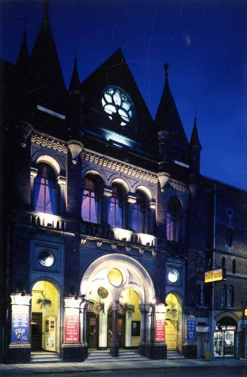 Grand Theatre Facade lit up at night.