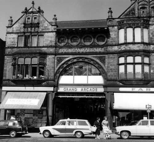 Black and white photograph of the outside of the Grand. The building has bay windows and lots of decoration.