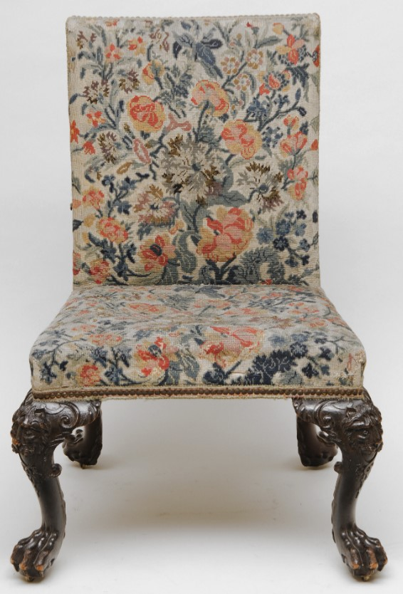 Straight backed chair with no sides. Padded seat and back, completely covered in embroidery with a design of flowers