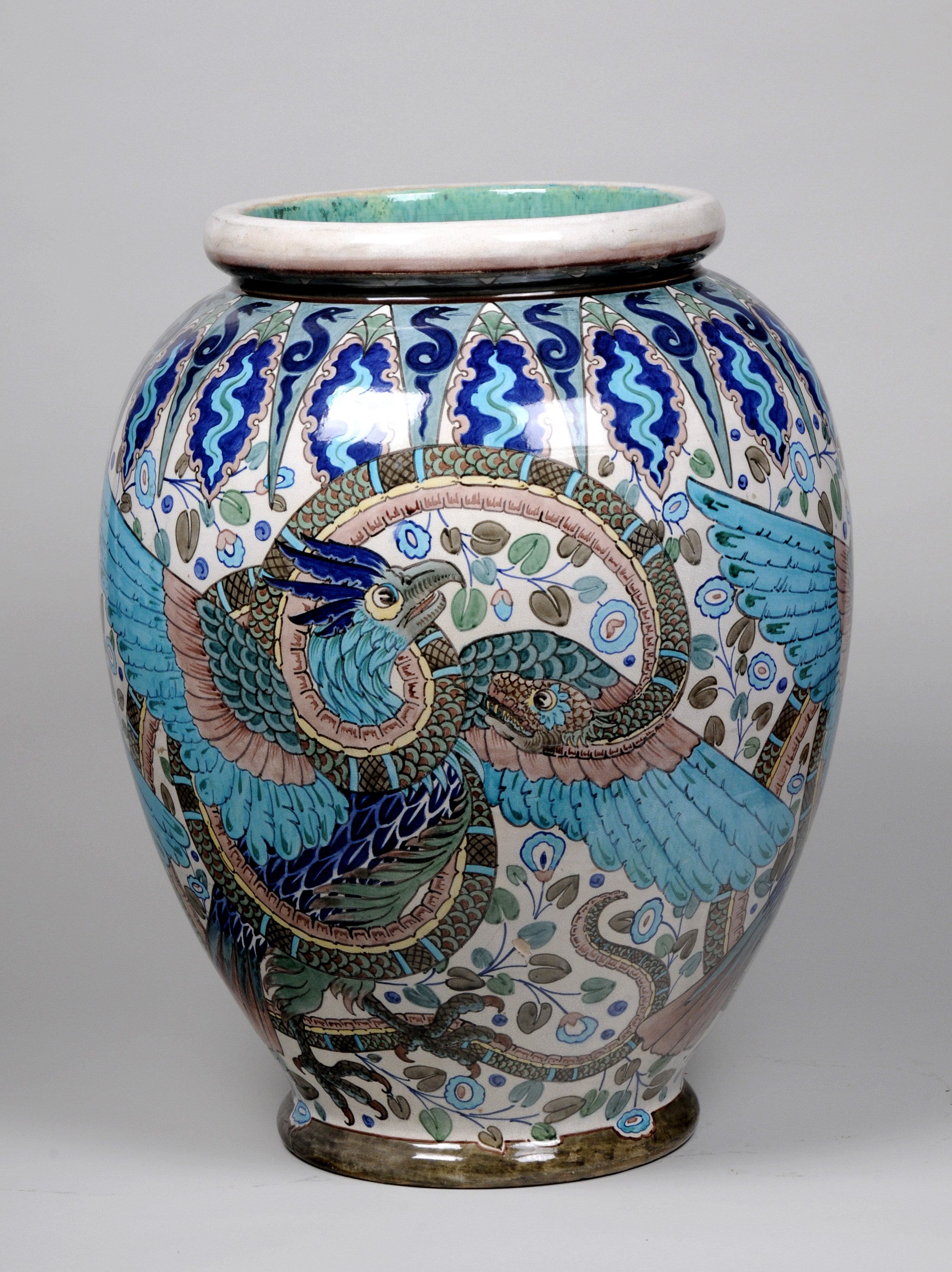 Ceramic vase in shades of blue glaze, with a phoenix and snake design.