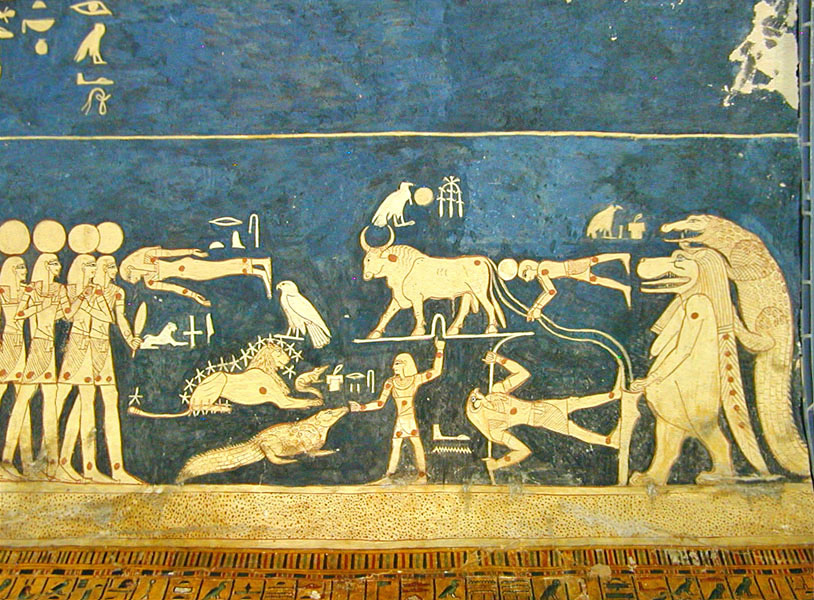 Colour photograph showing a scene with people, a crocodile, other animals painted in gold on a dark blue background.