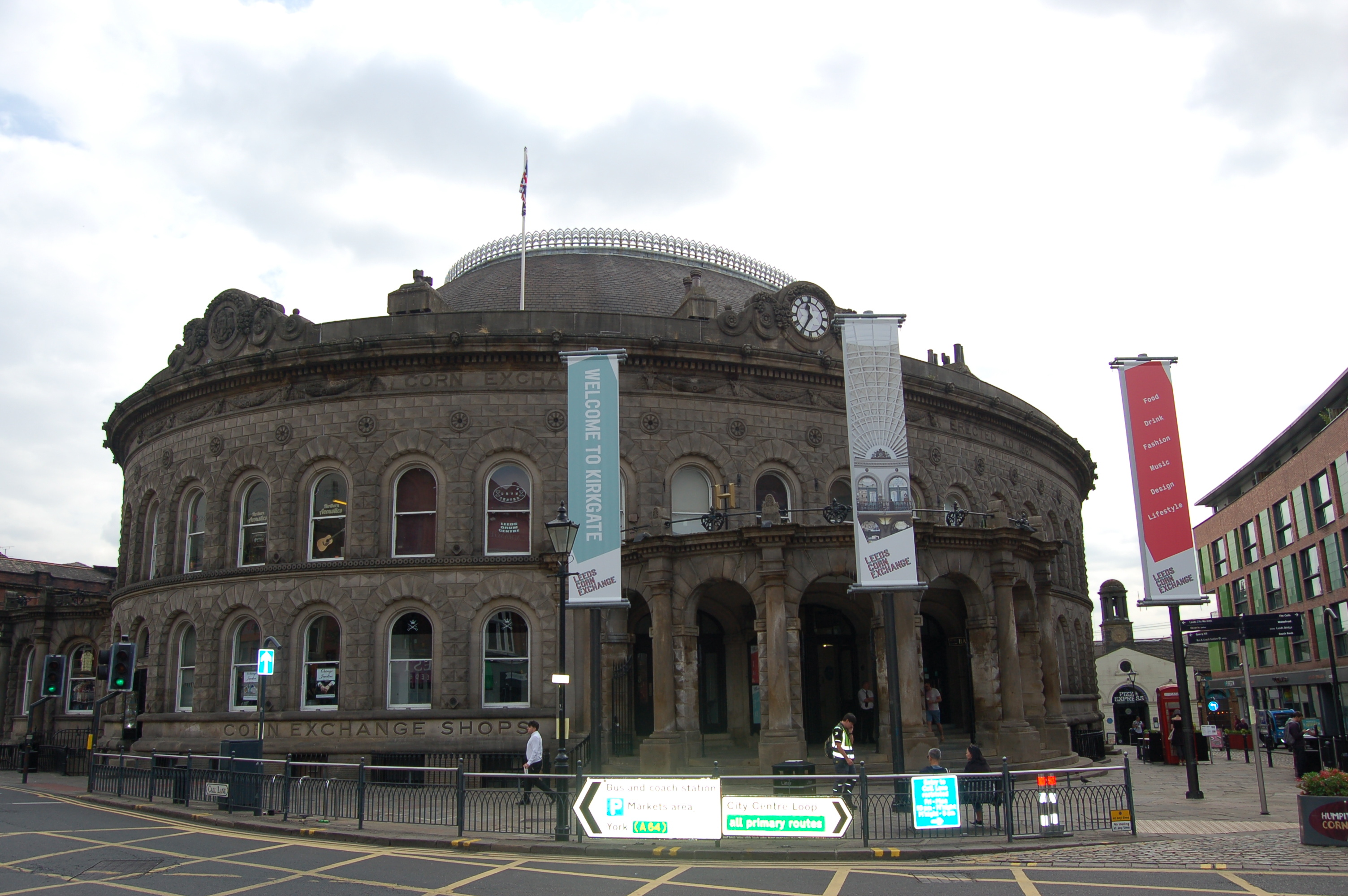 Contemporary photograph of the outside of the Corn Exchange, which is a round shaped building with a domed roof.