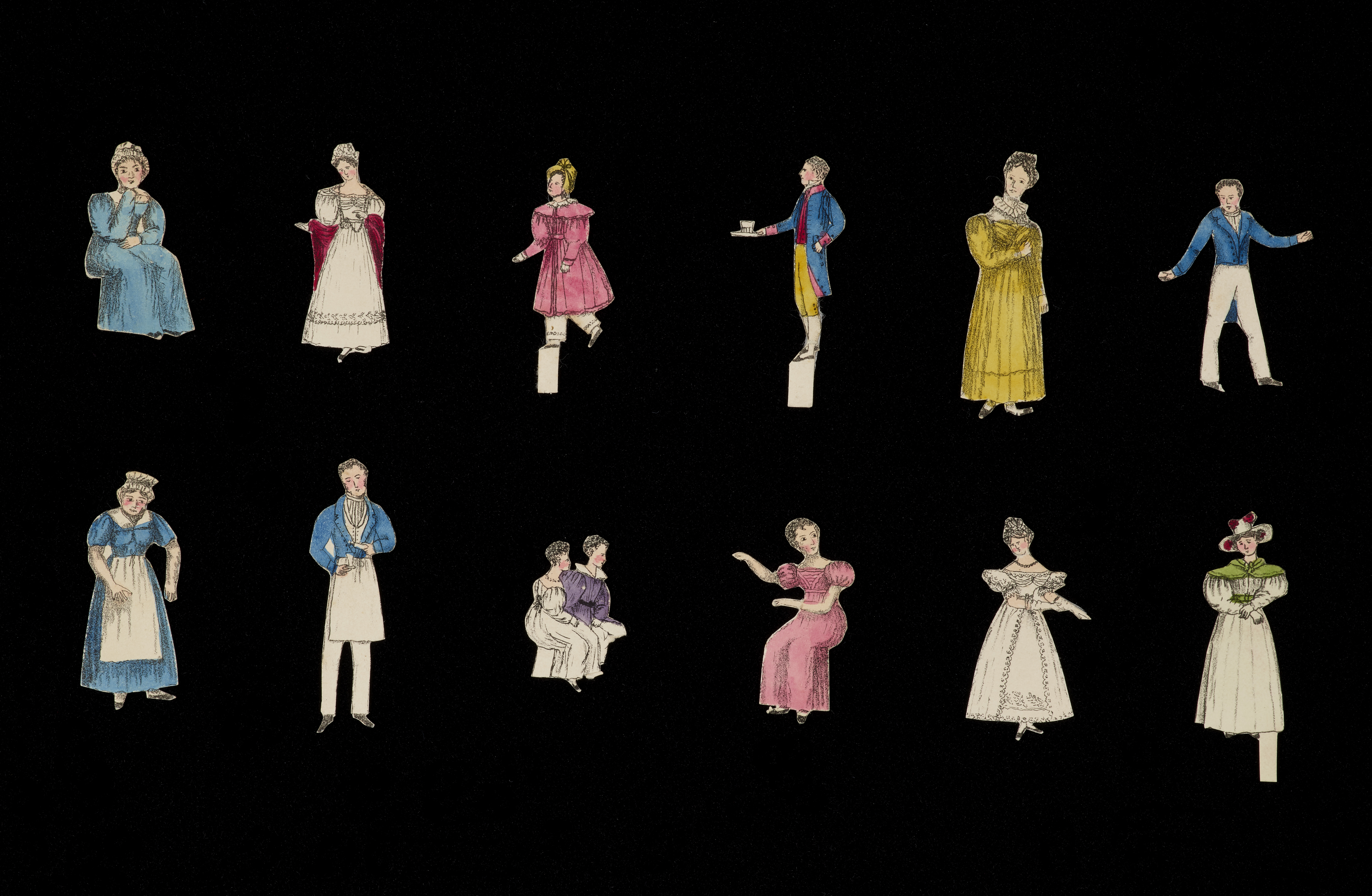 A selection of cut out cardboard figures of people, from women in rich dresses, to butlers and maids