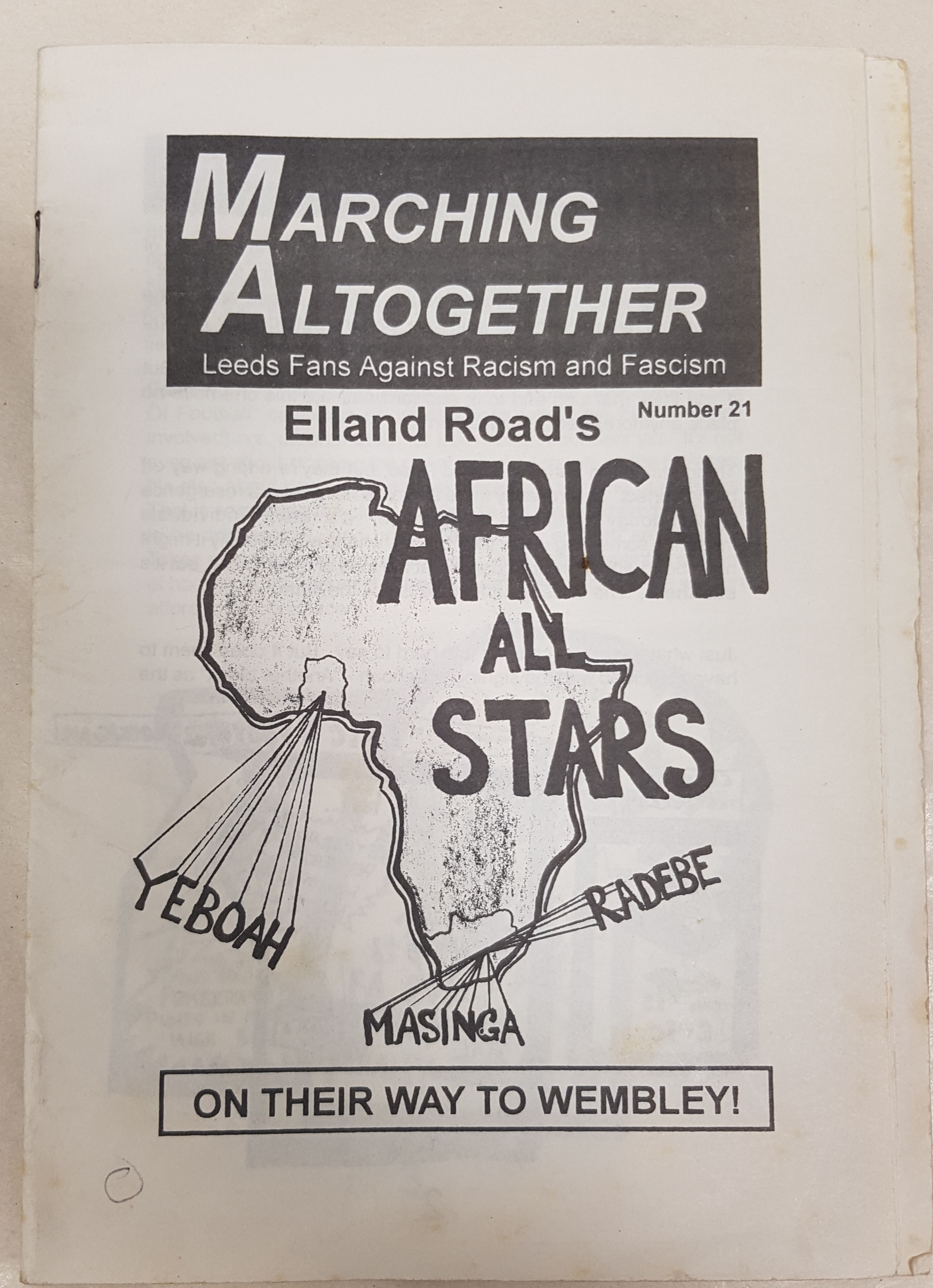 Photograph of the front of a fanzine with 'African All Stars' on the front, a map of Africa and the names of the Leeds players that come from there