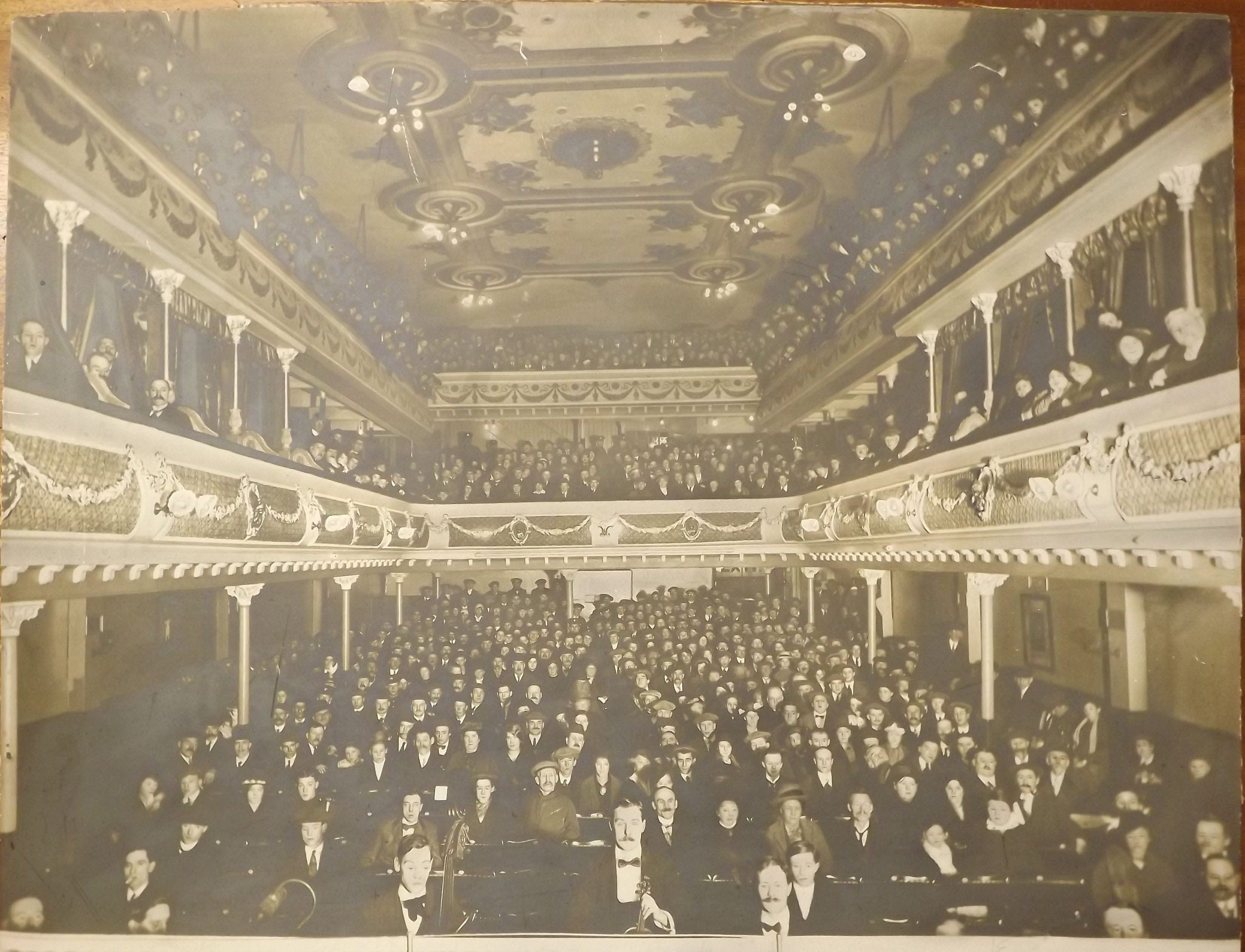 View from City Varieties stage showing a packed audience in the seats and both balconies