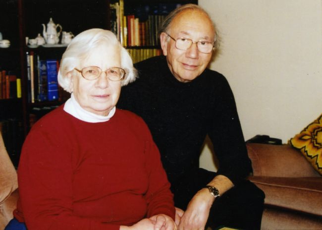 Colour photograph of an elderly  Heinz and Thea  in their home