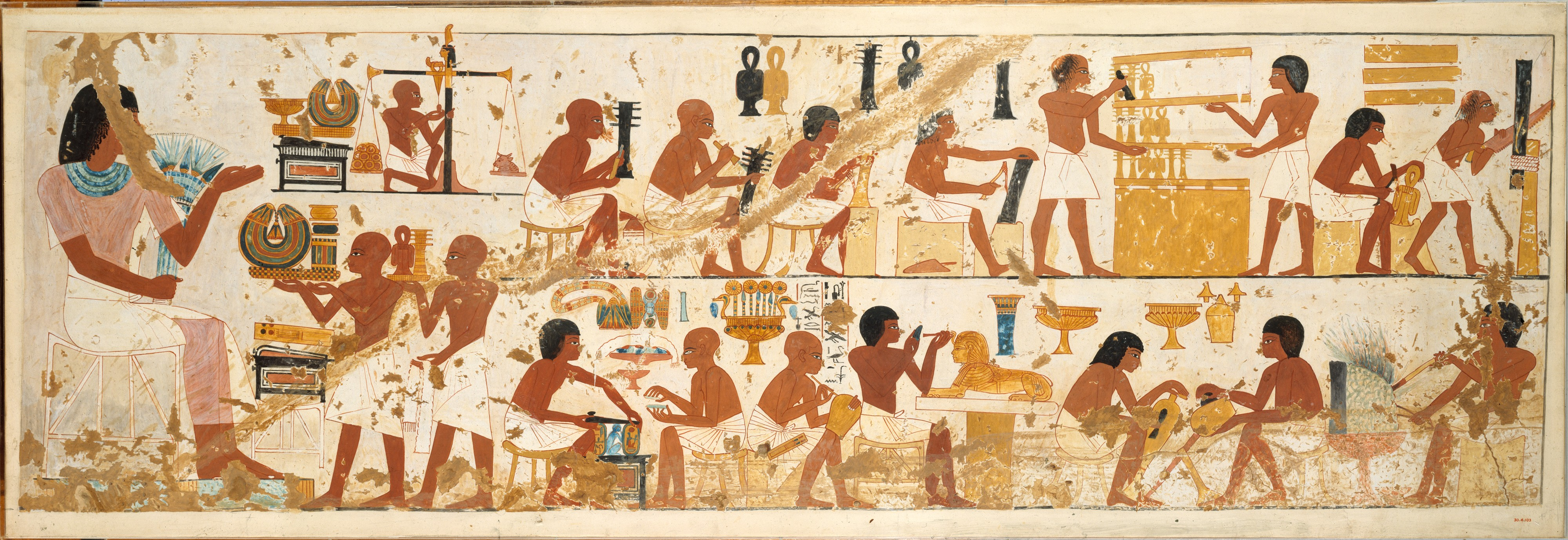 Colour photograph of a painting of lots of Ancient Egyptians doing different kinds of building work.