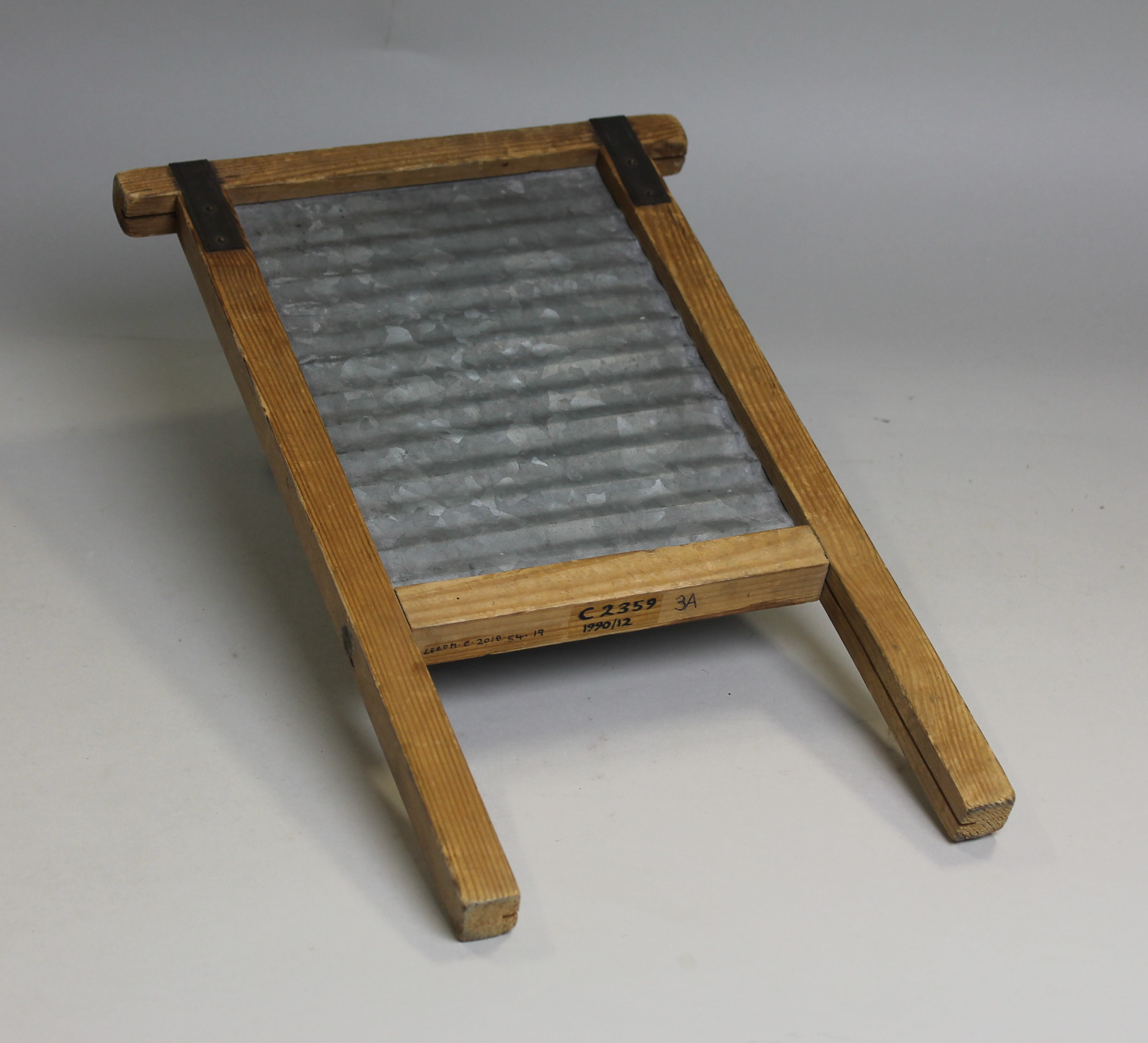 Wooden frame  holding a ribbed metal sheet