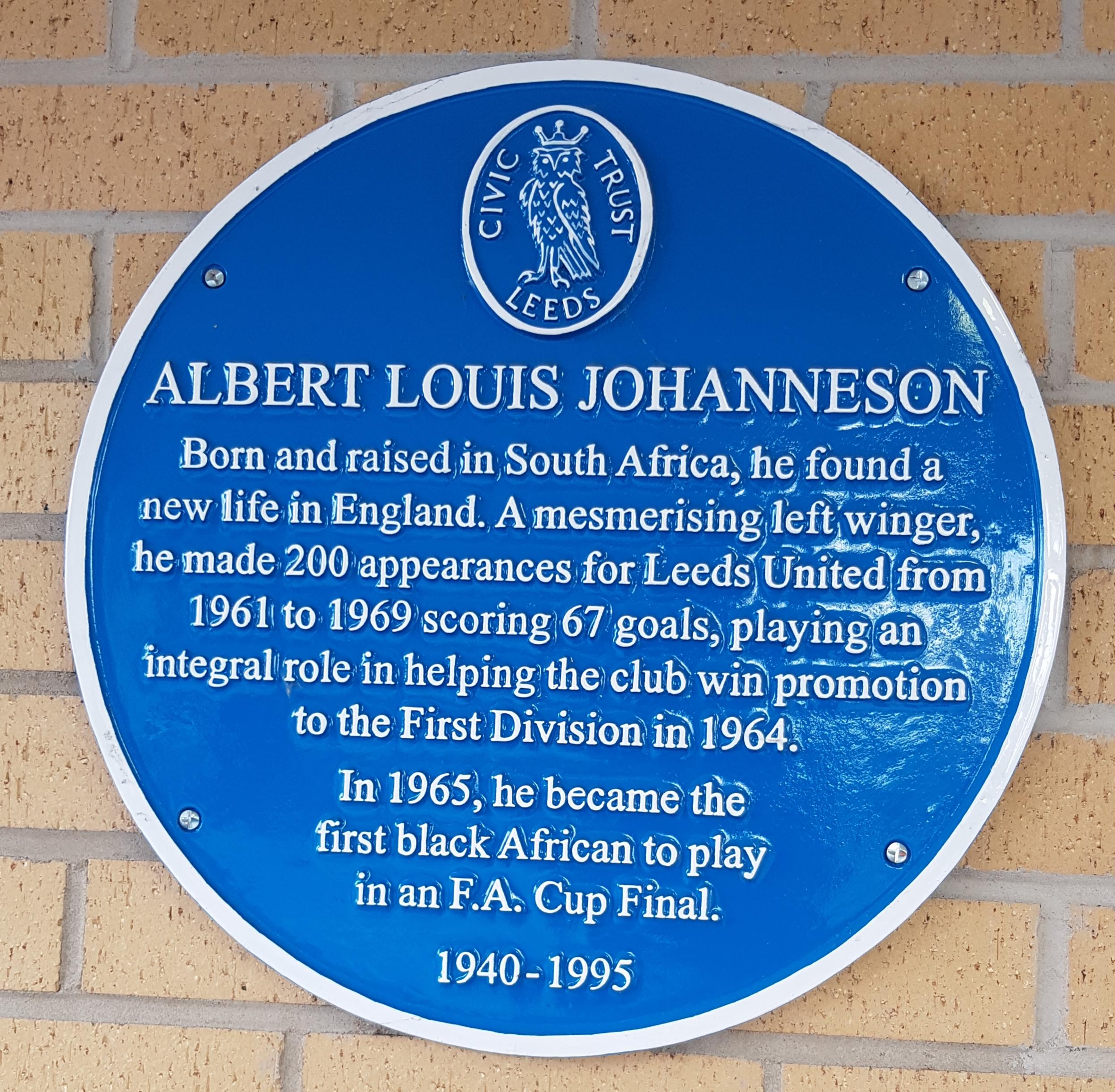 Colour photograph of a blue plaque