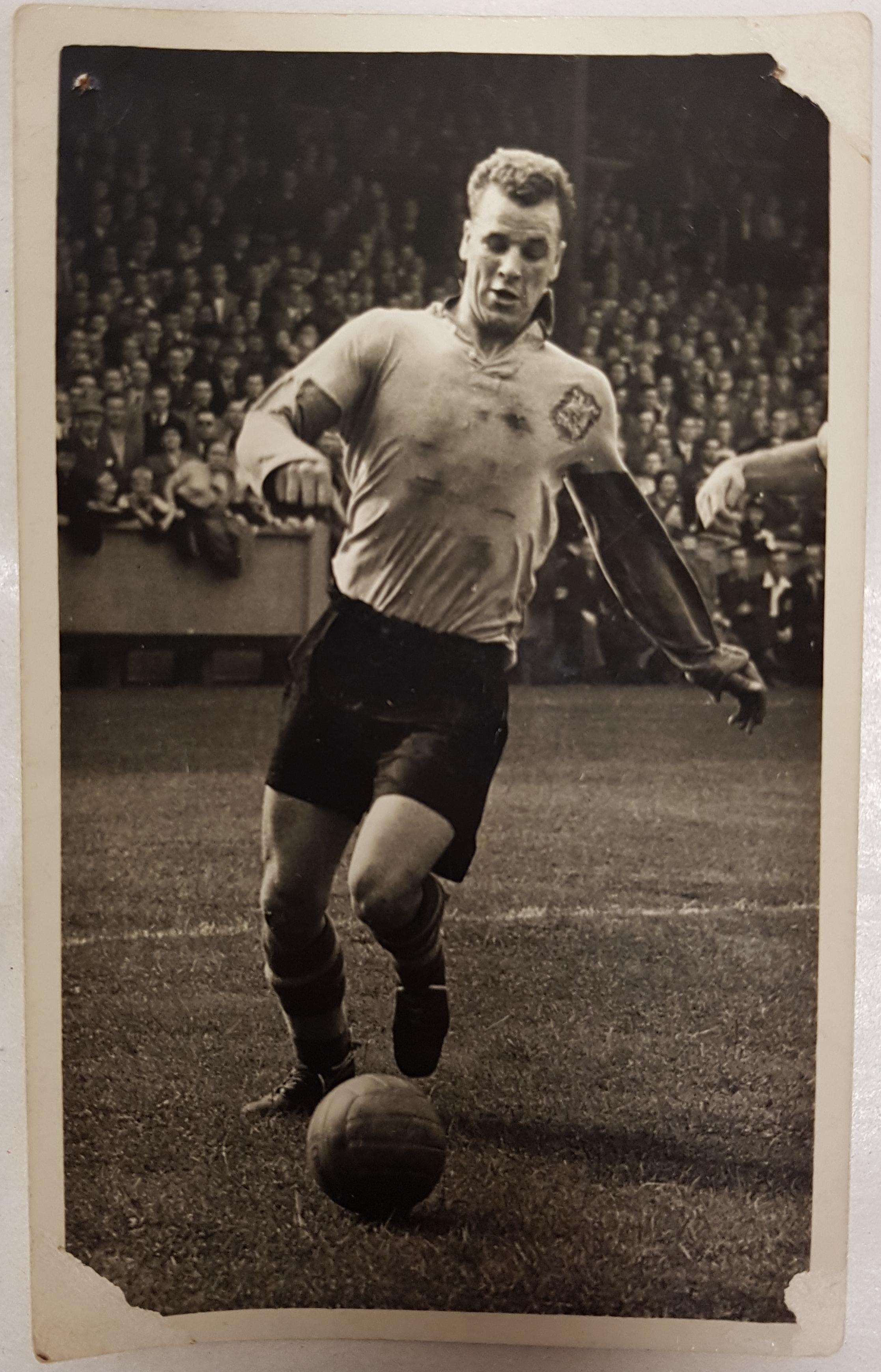 Black and white photograph of John Charles playing football