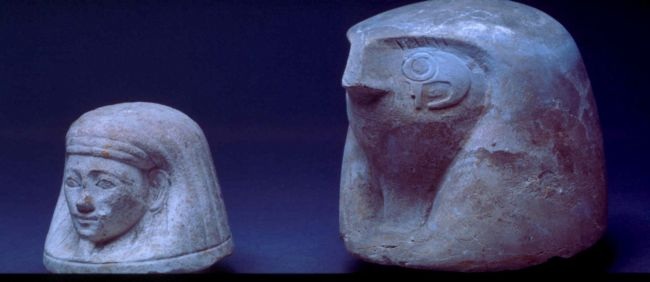 Two Canopic Jar Stoppers Depicting a Human Head and a Falcon's Head