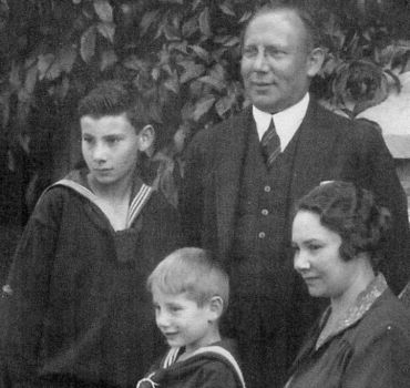 Black and white photograph showing a family of mother, father and two sons