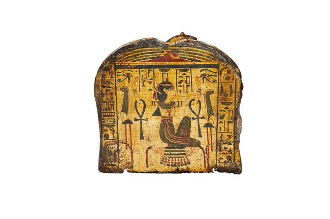 Foot end of Nesyamun's coffin showing the goddess Nephthys, protector of the mummy and the god Osiris, kneeling on the hieroglyph for gold with her arms raised.