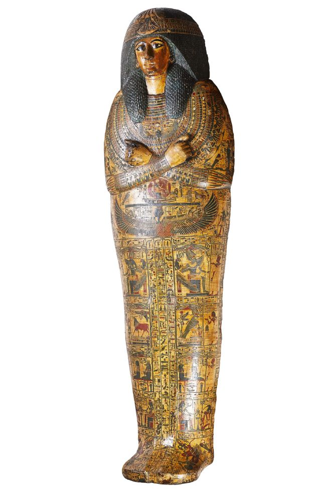 Outer coffin lid showing the painted face of Nesyamun.  Carved with his arms crossed over his chest and decorated with hieroglyphs.