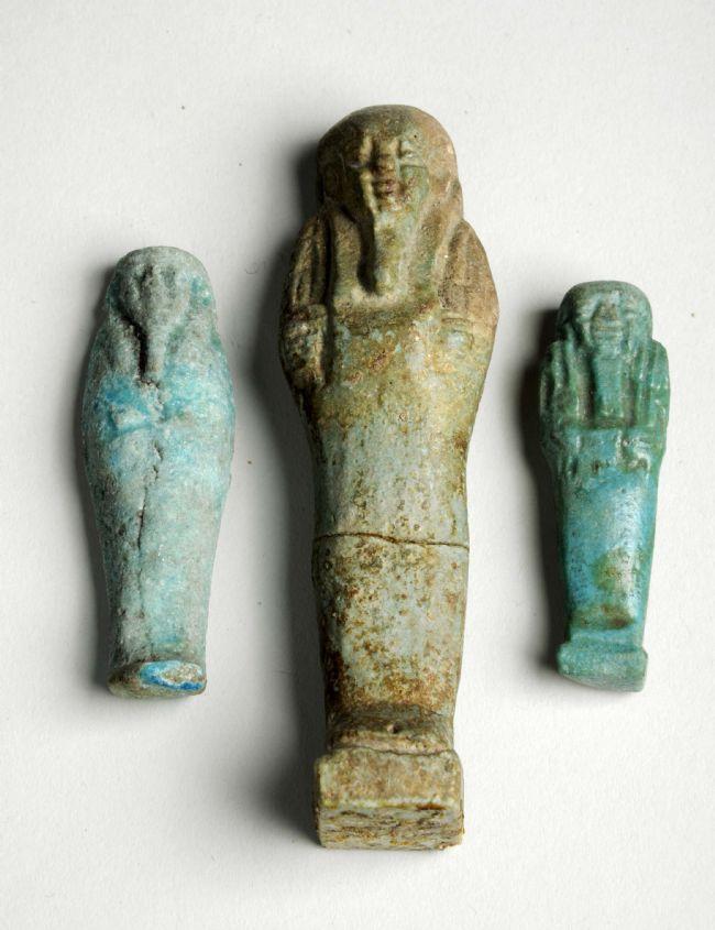 Three ceramic figurines of men with beards