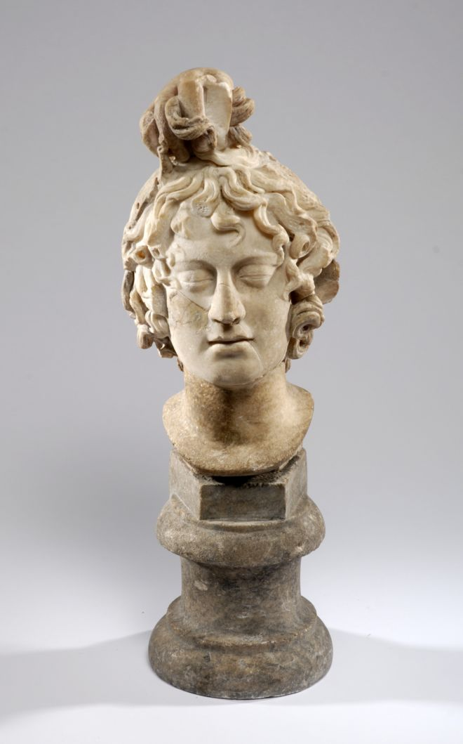The head is carved with a pile of snakes on the top.  It looks like Medusa's eyes are closed.