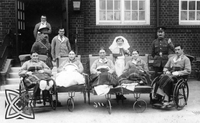 Group photograph of soldiers in hospital who have undergone amputations