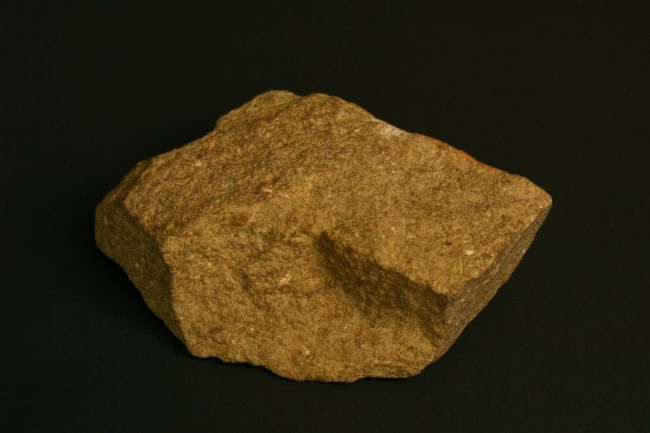 A dark yellow-ish rock with quite a fine texture
