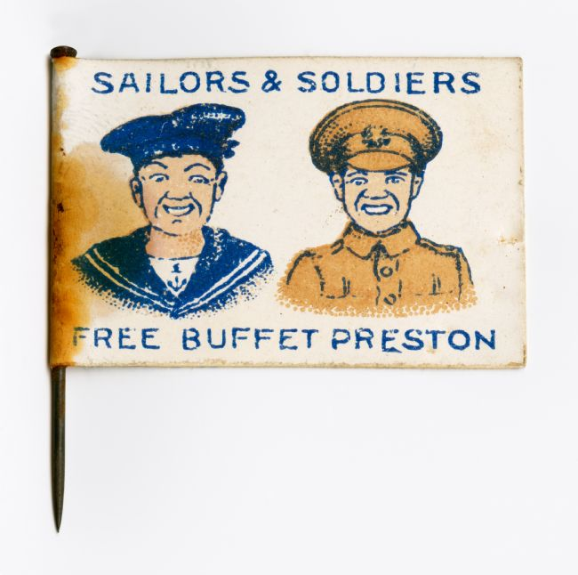 Paper flag showing an illustration of a soldier and a sailor with the words 'Soldiers & Sailors Free Buffet Preston' printed on it.