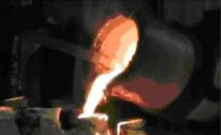 Molten bronze being cast