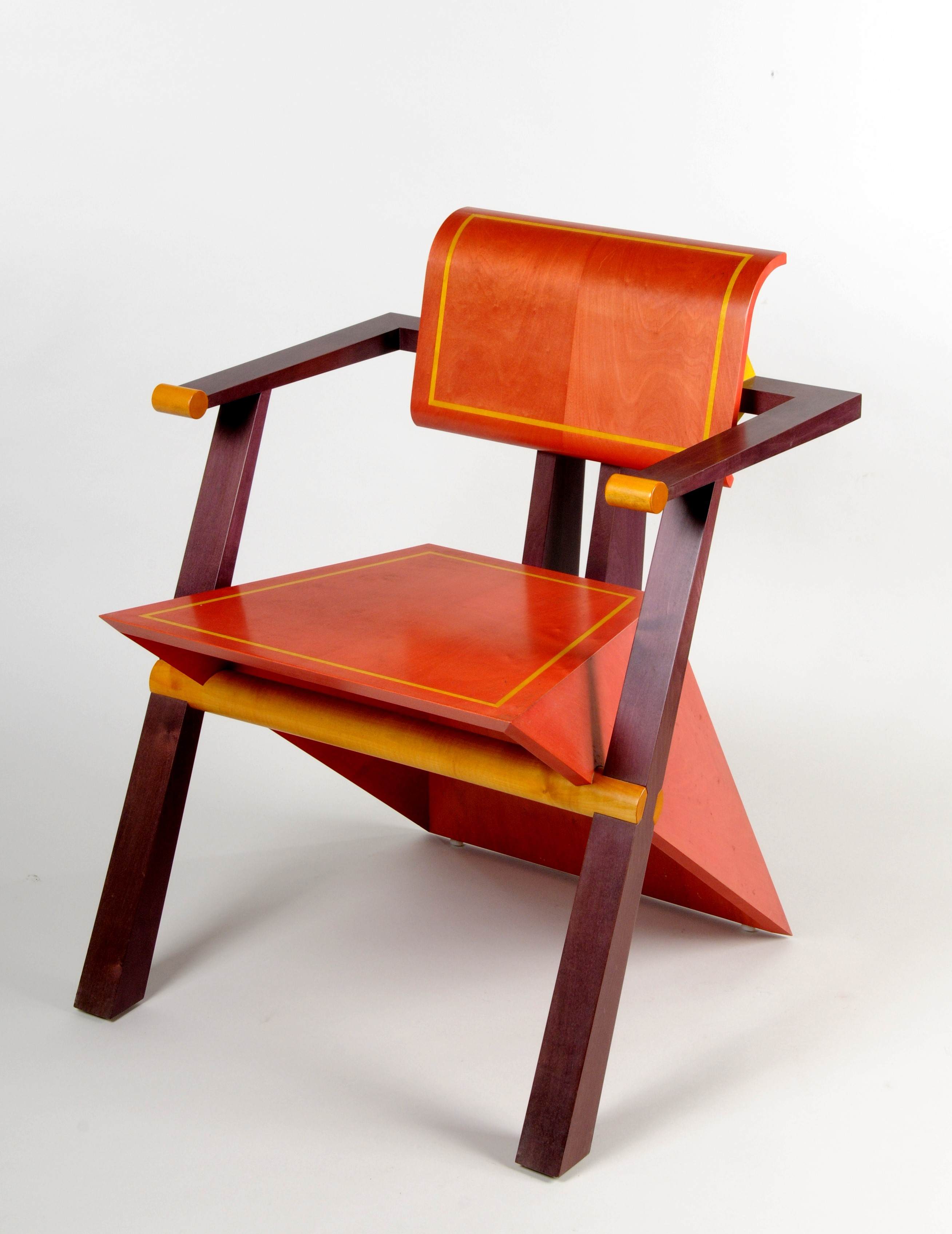 Wooden chair with two front legs and a prism shaped piece of wood forming the seat and the back legs.