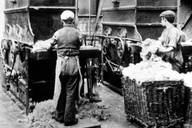 Children at Work - Black and white photo of two boys working in a mill