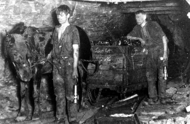 Children at Work - Black and white photo of two boys working in a mine