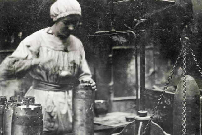 A Preston 'munitionette' filling shells at Dick, Kerr's & Co. munitions works during WW1