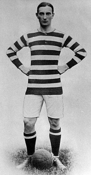 Black and white newspaper photo of Donald Simpson Bell in football kit.  His long-sleeved jersey is striped black and white, he wears white shorts and black socks.