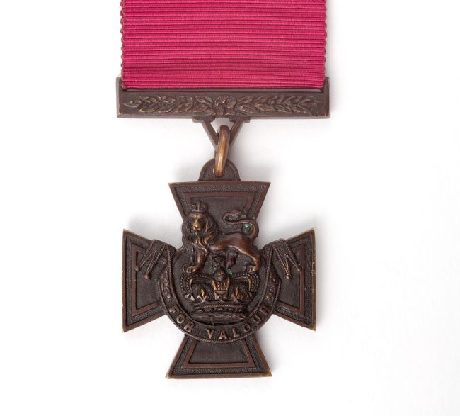 Front of a Victoria Cross medal showing a lion above a crown, with the words 'for valour'