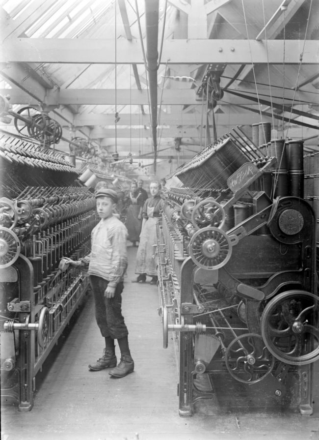 Boy at work in a textile mill