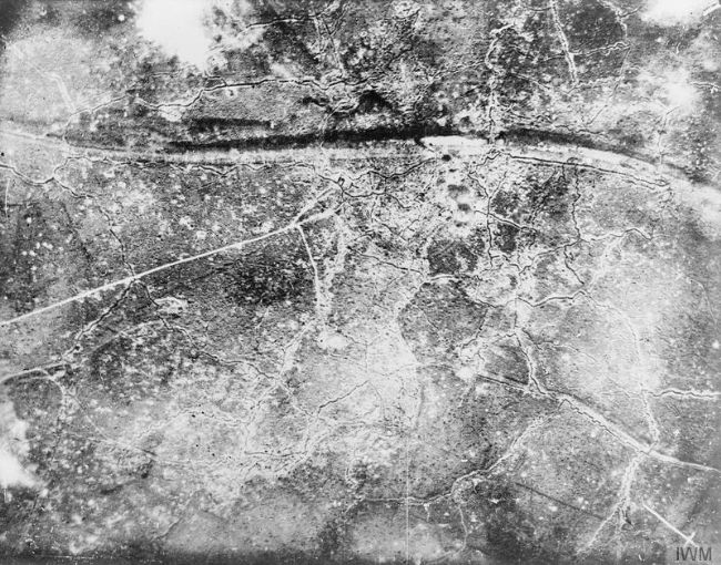 Black and white photograph taken from the air.  There are white lines and white splotches.