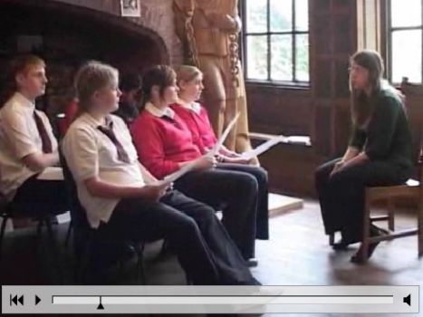 Students interviewing curator