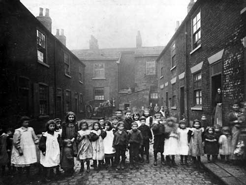 Back to back terraced housing with a group of children standing in the foreground. Photo taken in 1901