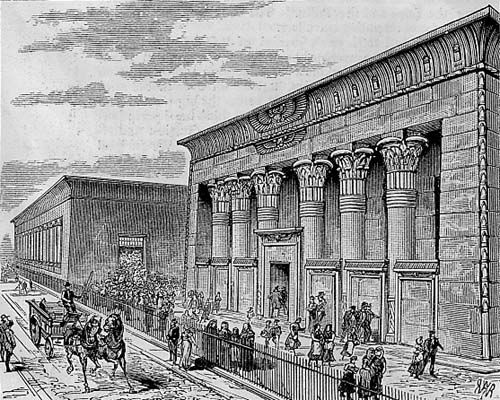 Illustration of Marshall's factory in Leeds, built with Egyptian style features.  People and a horse pulling a wagon in the foreground.