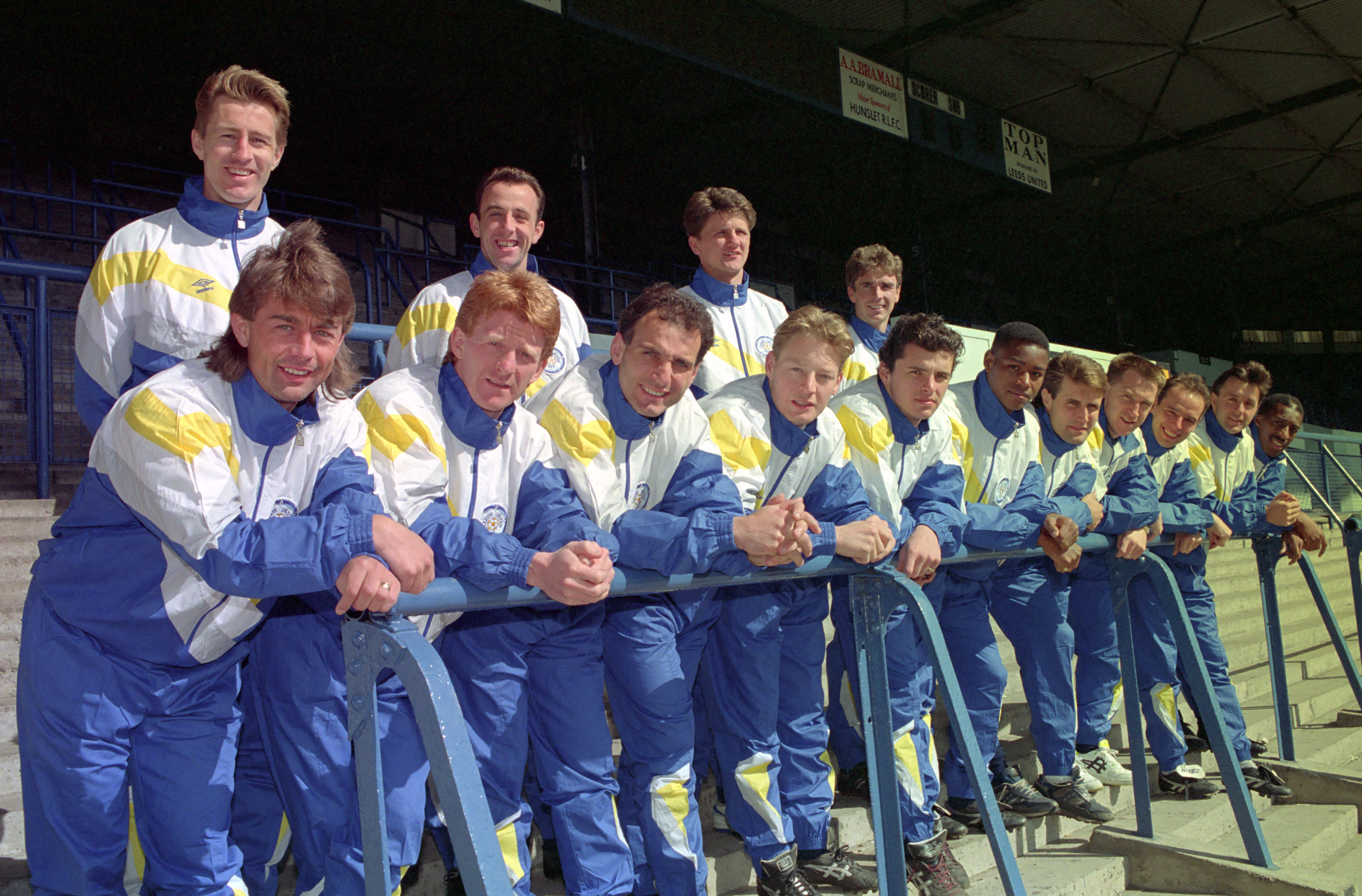 Leeds United team in 1990 wearing tracksuits in the blue and yellow colourway