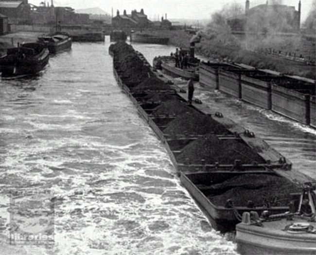 Two trains of Tom Puddings pass each other on the Aire and Calder Navigation canal