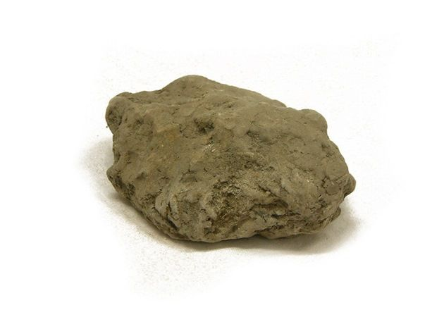 Lump of clay, grey bown in colour with rounded lumps and no sharp angles