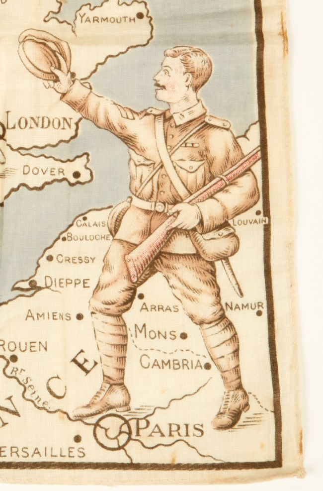 Image of a soldier on a printed handkerchief against a map of France