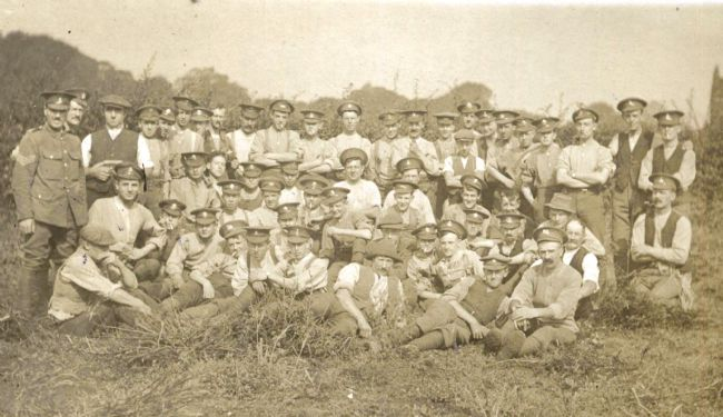 Black and white photo of WW1 soldiers helping with the harvest at Fisher's farm, Cottingham