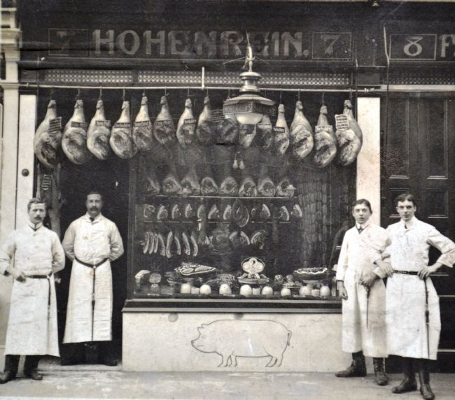 Charles Hohenrein standing in the doorway of his pork butchers' shop at 7 Waterworks Street, Hull, with his staff in about 1910