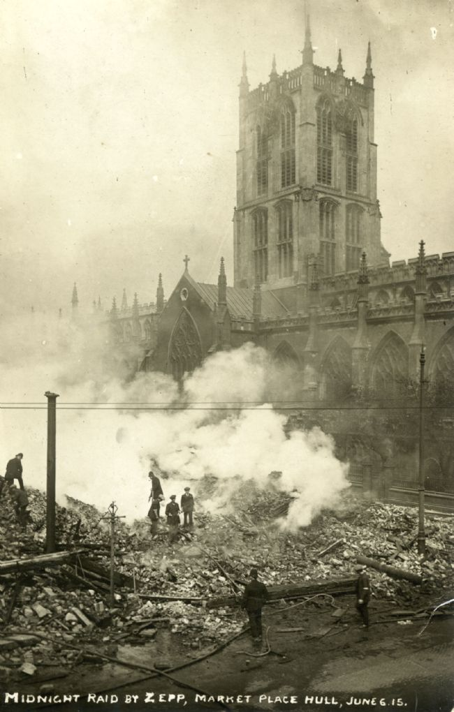 Photograph showing damage caused by a Zeppelin raid on Market Place in Hull on 6 June 1915.