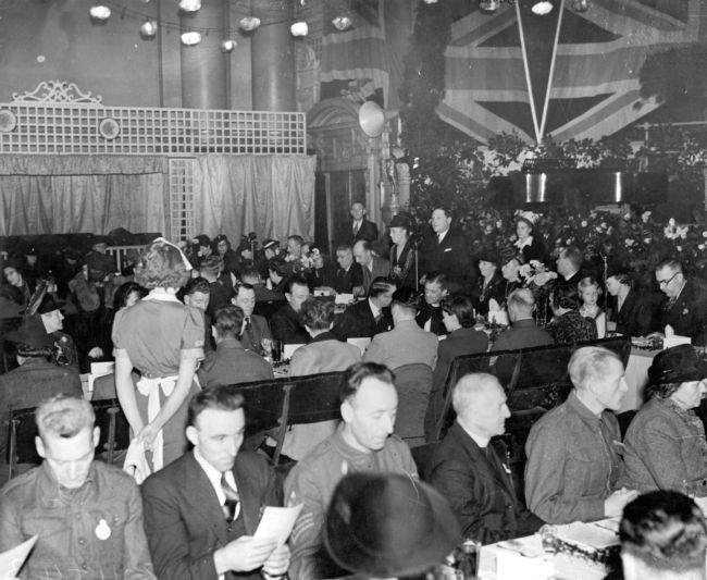 people sitting at tables in theTown Hall