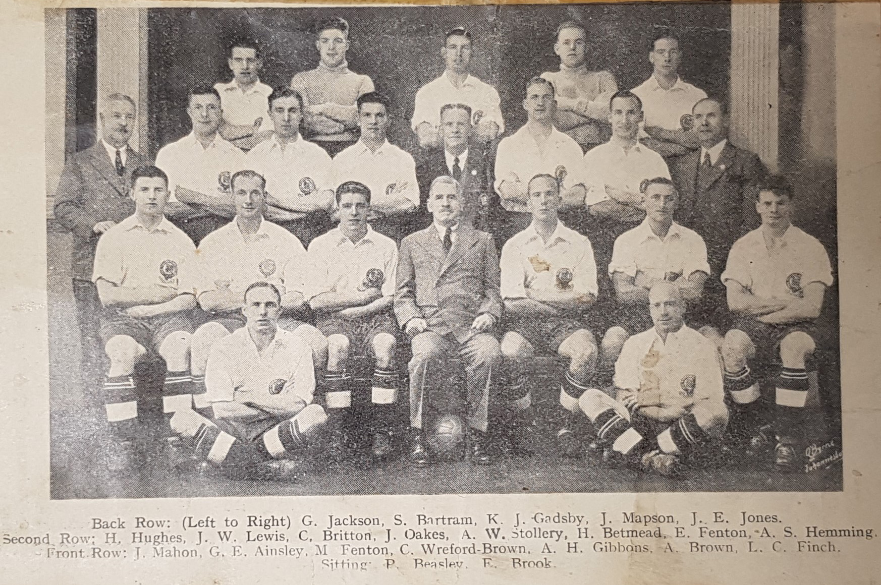 Black and white photograph of the football squad sitting for a formal photograph