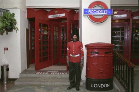 Man in bearskin outside UK themed restaurant in India