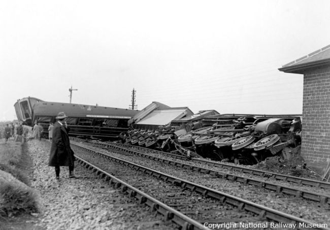 1926 photo of derailed locomotive lying on its side